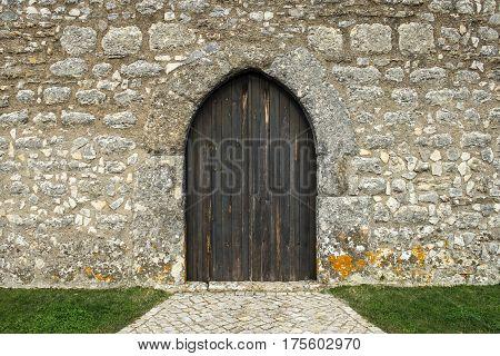 Castle's back door with door of wood