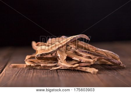 Dried lingzhi mushroom (Also called as Reishi mushroom in Japan Lingcheu in Thailand Lingzhi mushroom in China Ganoderma Lucidum Karst or lacquered mushroom) on dark background