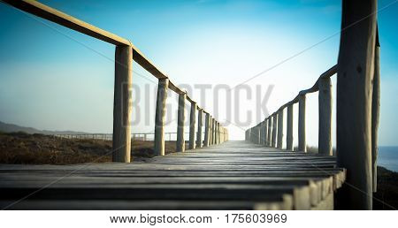 Beach walkway to infinity with gradient background