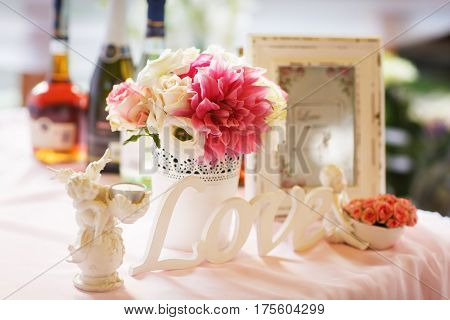 Tender Decor Of A Table With Lettering 'love', Pink And White Flowers