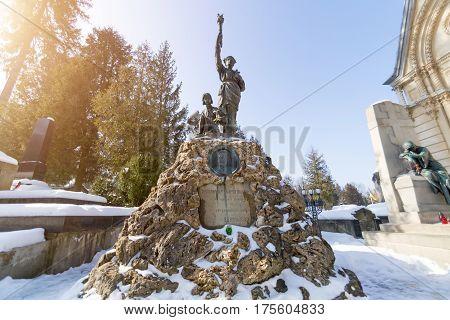 Lviv, Ukraine - Feb 14, 2017: Old Statue On Grave In The Lychakivskyj Cemetery Of Lviv, Ukraine. Off