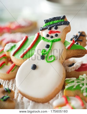 Delicious homemade christmas cookies with a snowman on white.