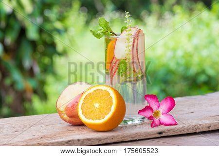 Detox Water with orange, healthy herb Detox Water Detox water with apples Orange and lemon.