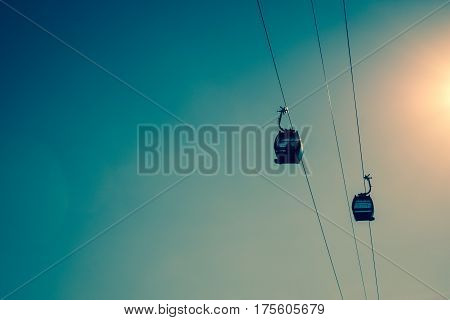 Two cable cars in a blue sky at at midday