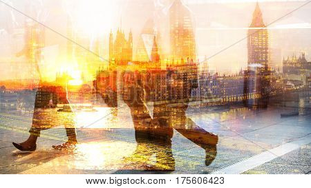 Feet of pedestrians walking against of London view and Big Ben at sunset. Multiple exposure image. Modern life concept