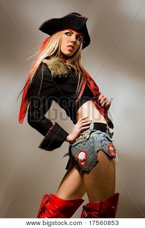 Sexy model wearing pirate outfit and red boots