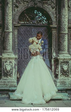 Handsome African Groom Hugging Cute Bride