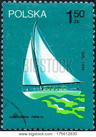 UKRAINE - CIRCA 2017: A stamp printed in Poland shows old sailing yacht Dal participated in the circumnavigation in 1934 circa 1974