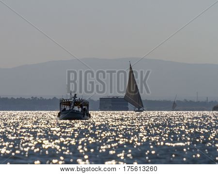 Nile river. Ships yachts fishing boats against the backdrop of ancient temples