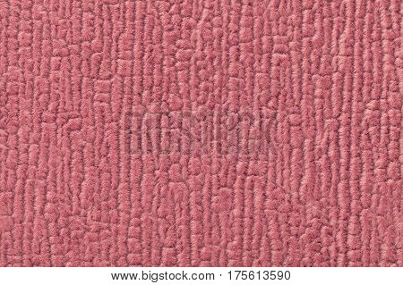Pale red fluffy background of soft fleecy cloth. Texture of textile closeup.