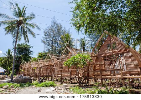 The construction of the guest houses is made from natural resources on the beach with palm trees. Indonesia