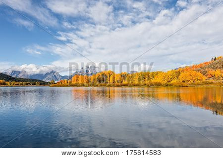 a scenic reflection of the Tetons in fall at Oxbow Bend Teton National park