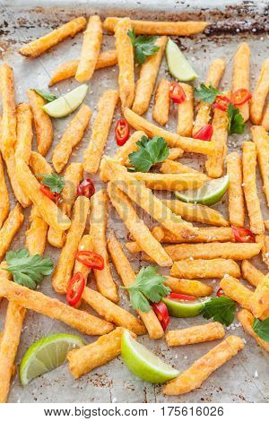 Crispy fries made from sweet potatoes with chili and lime