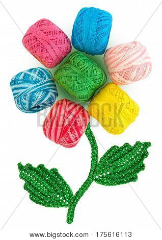Composition in the form of a flower. Flower bud consists of multi-colored skeins of yarn. Leaves and stem are crocheted.