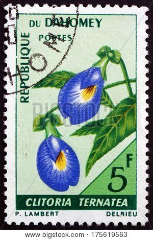 DAHOMEY - CIRCA 1967: a stamp printed in Dahomey shows Butterfly pea clitoria ternatea is a perennial herbaceous plant circa 1967