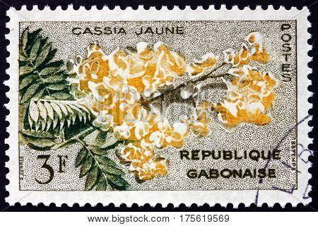 GABON - CIRCA 1961: a stamp printed in the Gabon shows Yellow cassia cassia fistula is a flowering plant circa 1961