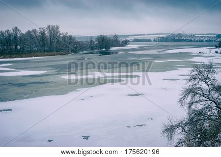 Winter landscape with frozen Dnepr river near Dnepropetrovsk city Ukraine