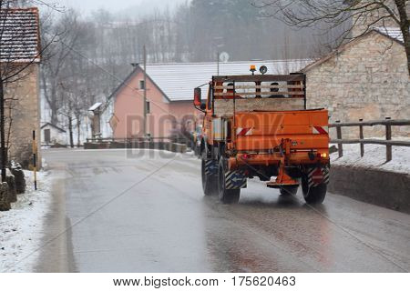 salt spreader on the road operating in winter