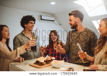 Happy group of friends making a toast together.