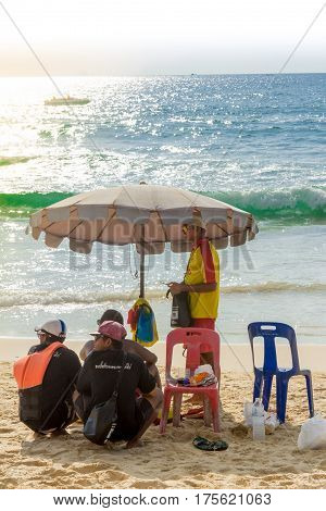 Rescuers watch the sea under an umbrella from the sun