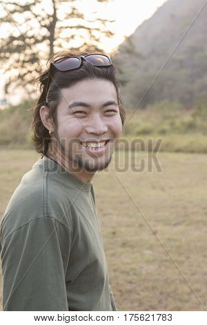 asian younger man toothy smiling face happiness emotion standing outdoor