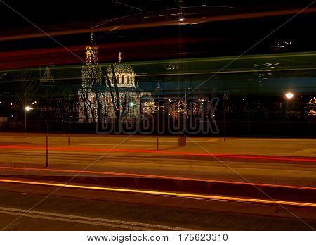 Tram and church. Lodz, Poland - March 04, 2017 Fuzzy traffic tram urban, against the background of the Orthodox Church of Alexander Nevsky Cathedral.