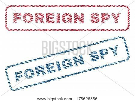 Foreign Spy text textile seal stamp watermarks. Blue, red fabric vectorized texture. Vector tag inside rounded rectangular shape. Rubber emblem with fiber textile structure.
