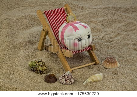 deckchair with piggy bank and euro