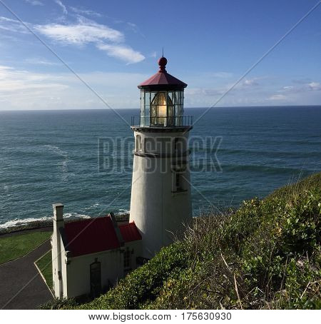 Bluff view of Heceta Head lighthouse on Oregon coast.