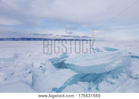 Turquoise Ice Floe. Winter Landscape. Ice-drift. Baikal Lake