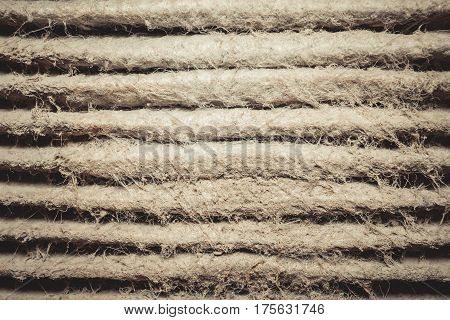 Detailed fragment of dirty air filter surface. Background texture.