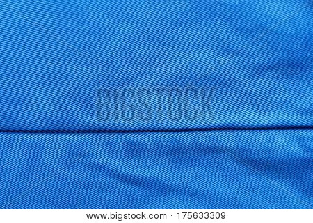 Blue fabric for clothing background with horizontal seam Blue cloth as blank backdrop