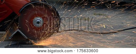 Cutting disc for metal. The sparks of hot metal when cutting steel profiles.