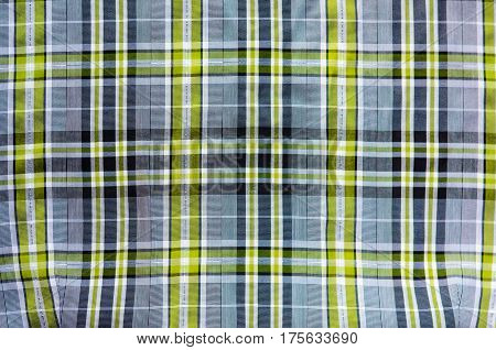 Fabric for clothing background. Grey and green cloth as blank backdrop