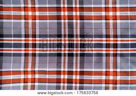 Fabric for clothing background. Grey and red cloth in a cage as blank backdrop
