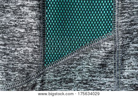 Element of clothing for sports. Mesh finishing fabric detail. Clothing fabric for outdoor activities