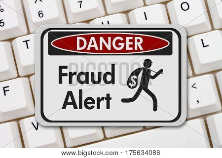 Fraud alert danger sign A black and white danger sign with text Fraud Alert and theft icon on a keyboard 3D Illustration