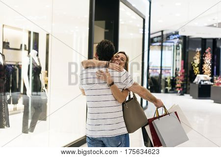 Couple Glad Cuddle In Shopping Mall