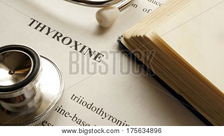 Document with title Thyroxine on a table.