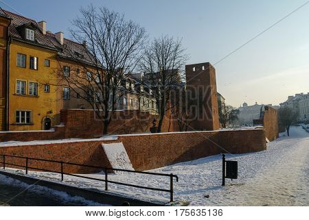 Towers And Red Brick Walls Of The Historical Warsaw Barbican Fortress, Poland