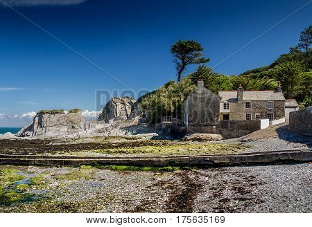 Stone houses on the shore of the Bay of Lee in northern Devon. Good weather. Sunny. Summer. England