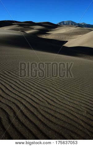 Shadows and wind produced ripples in the sands of the Great Sand Dune National Park in southern Colorado near Alamosa