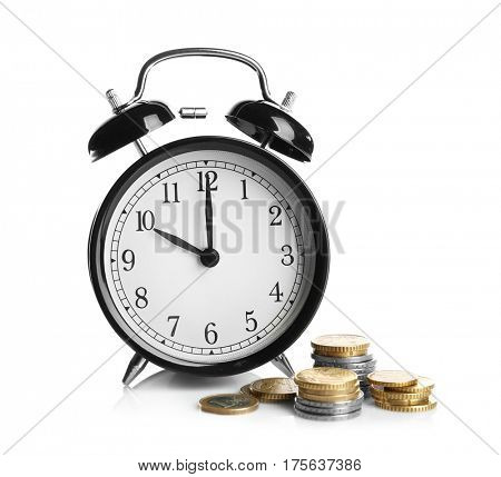 Alarm clock and coins on white background
