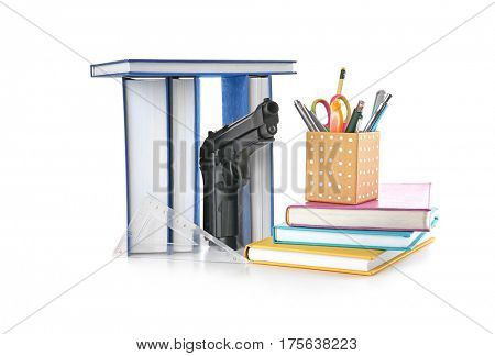School stationery and gun isolated on white