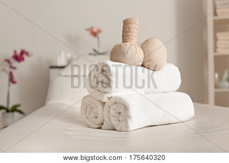 Towels with herbal bags in spa center
