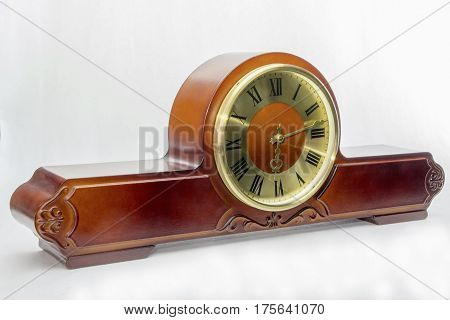 Wooden antique mantel clock with golden dial