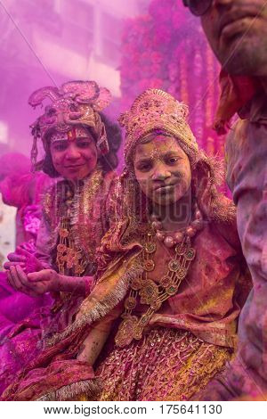 Mathura, India. March 23, 2016. Indian children dressed as Hindu deities participate during colourful Holi procession on the streets of Vrindavan, Uttar Pradesh, India.