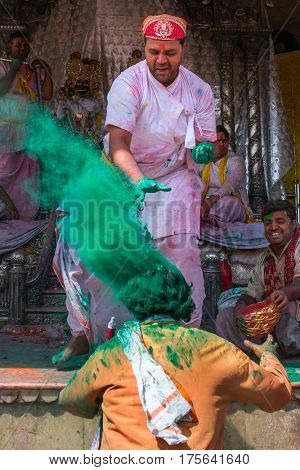 Nandgaon, India - March 17, 2016: Devotees celebrate Lathmar Holi in Nandgaon village, Uttar Pradesh, India.
