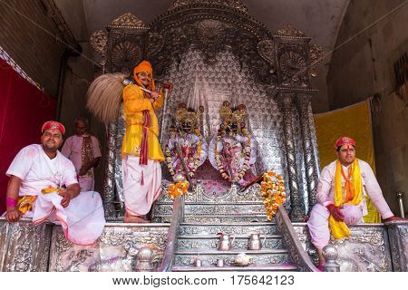 Barsana, India - March 17, 2016: Devotees celebrate Lathmar Holi in Barsana village, Uttar Pradesh, India.