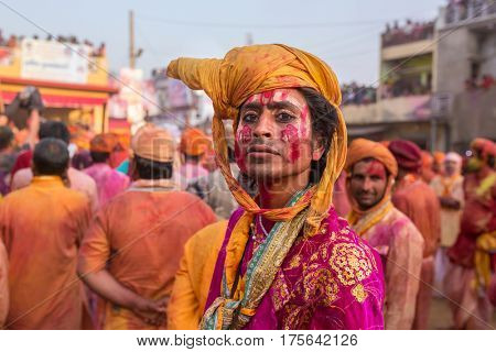 Nandgaon, India - March 18, 2016: Barsana villagers come to Nandgaon village to celebrate Lathmar Holi in Nandgaon, Uttar Pradesh, India.